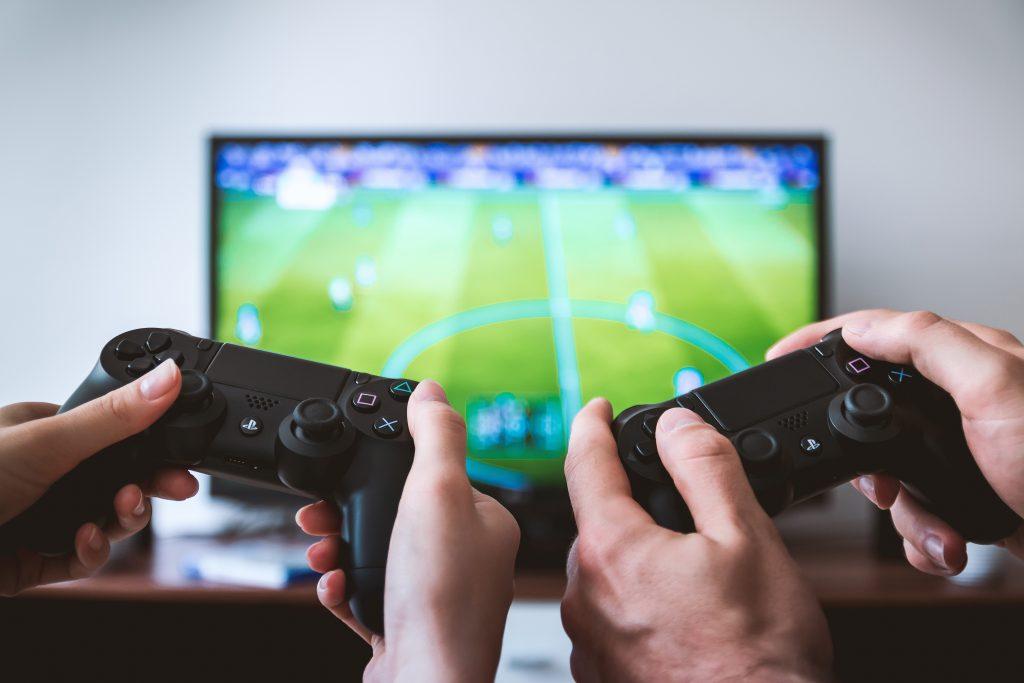 Man & woman playing video games